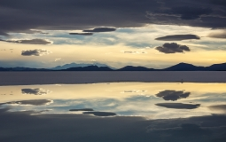 Sunset sky reflected in brine pools on the Salar