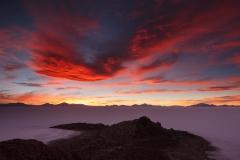 Pescado Island with sunset sky