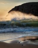 Backlit surf and spray